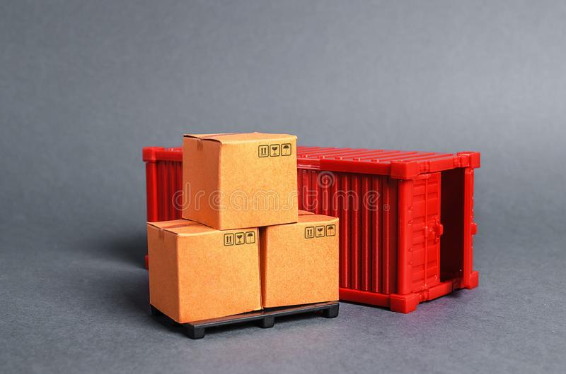 Red cargo container with boxes. Business and industry, transport infrastructure. The concept of commerce and trade, cargo delivery. Exchange of goods royalty free stock image