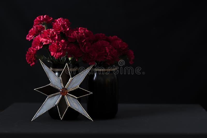 Christmas Arrangent of Flowers ad Stained Glass royalty free stock image