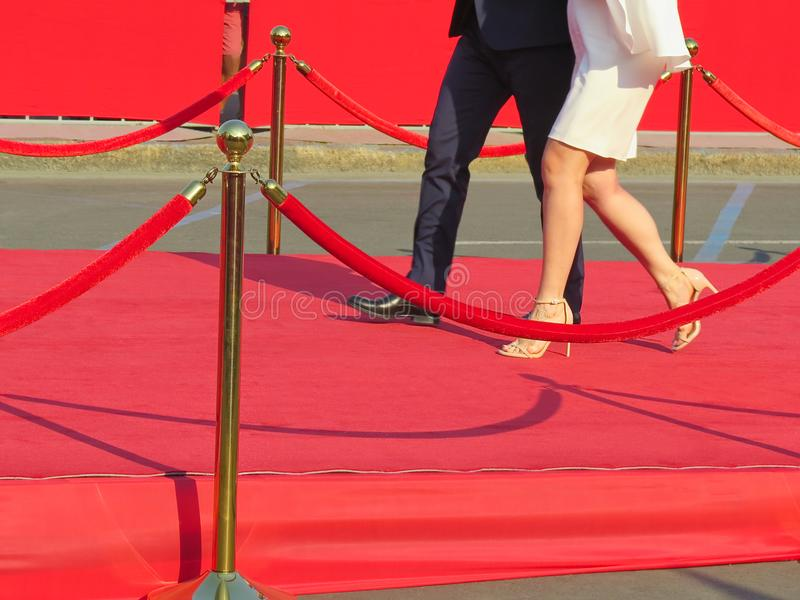 Red carpet entrance with golden stanchions and ropes. Celebrity nominees to premiere. Stars on the festive awarding of prizes. Awards stock image