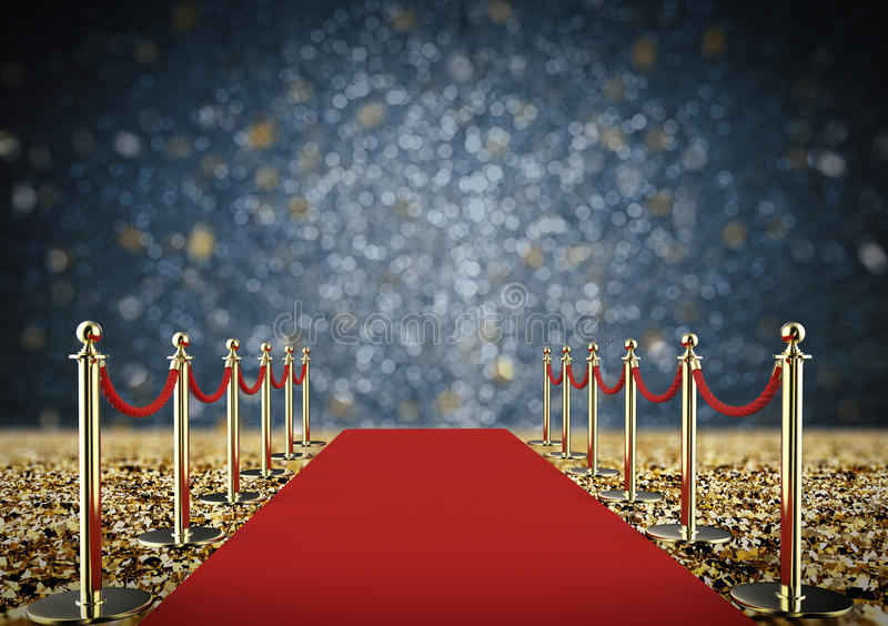 Red carpet and rope barrier with shiny gold glitter royalty free stock photo