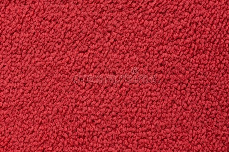 Red carpet surface close up. Abstract texture and background royalty free stock image