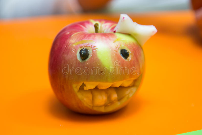 Red carving apple royalty free stock images