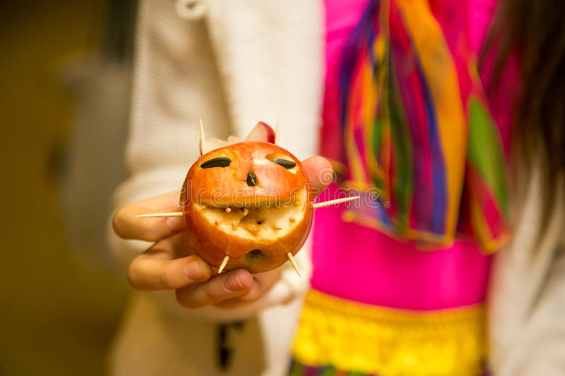 Red carving apple smiling royalty free stock photo