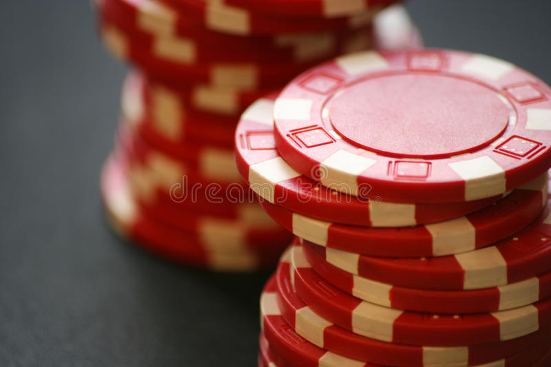 Red casino chips. Two piles of red casino chips royalty free stock photography