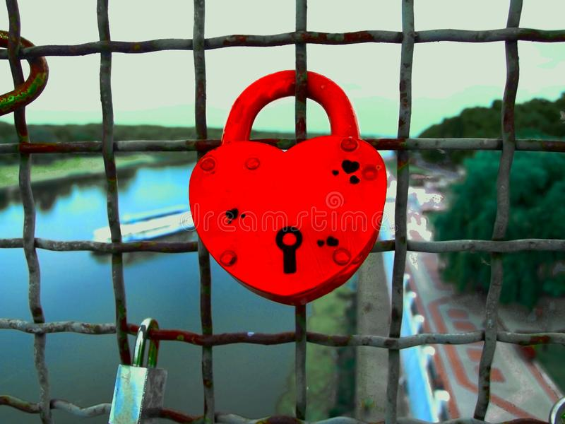 Red castle heart on the fence, wedding, Valentine`s day, symbol of love stock images