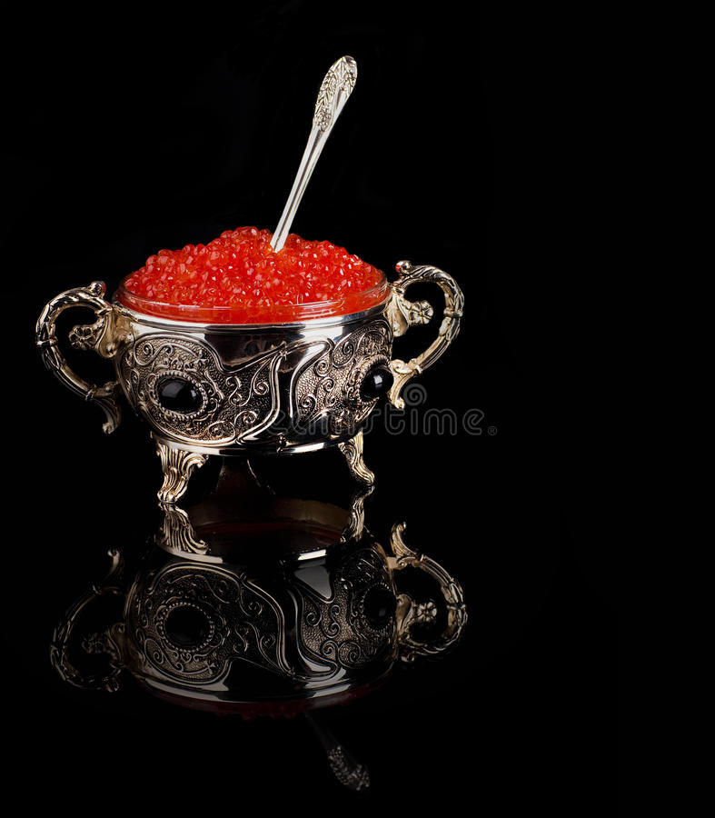 Red caviar. Pancakes with red caviar on silver ware royalty free stock images