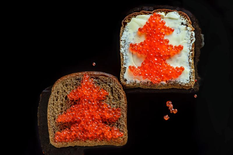 Red caviar on black bread in the form of a Christmas tree royalty free stock photo