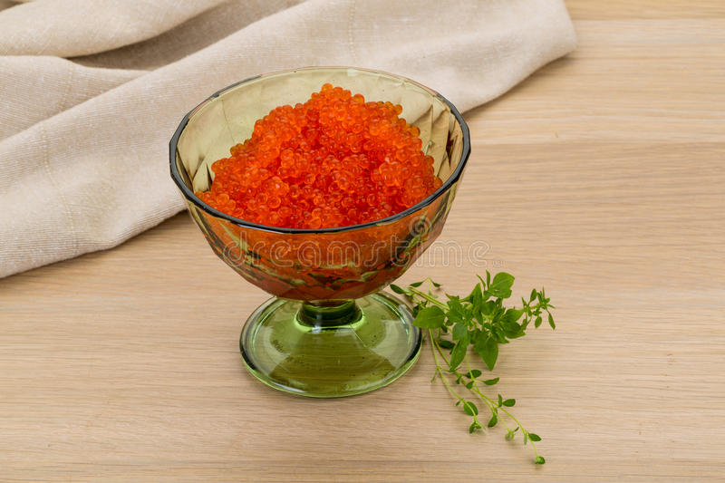 Red caviar. In the bowl on desk royalty free stock images