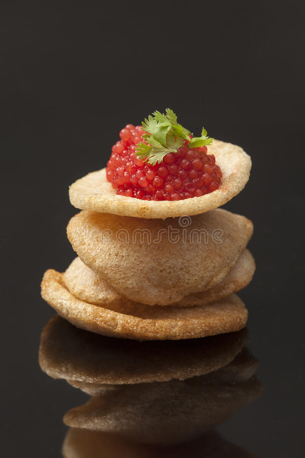 Red caviar. Image is posed on dark background royalty free stock photography