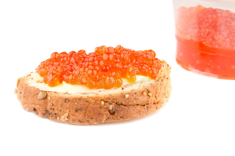 Red caviar sandwich and a jar royalty free stock photos