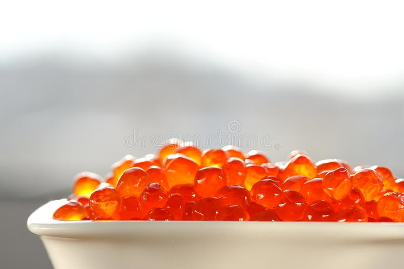 Red caviar in white bowl royalty free stock photography