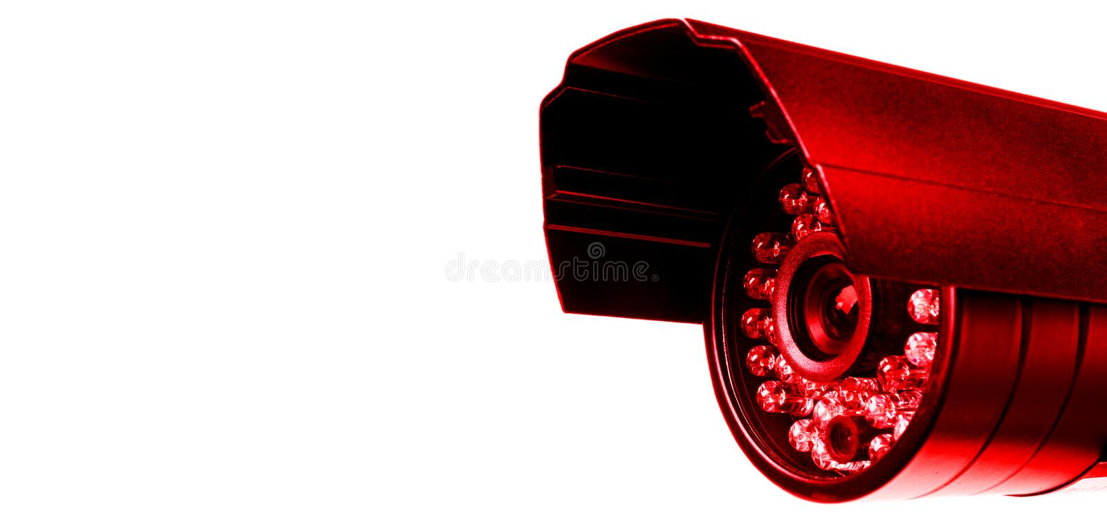 Red CCTV security camera video equipment. Surveillance monitoring. Video camera lens closeup. Macro shot. Security concept. Securi. Ty camera isolated on white stock photo