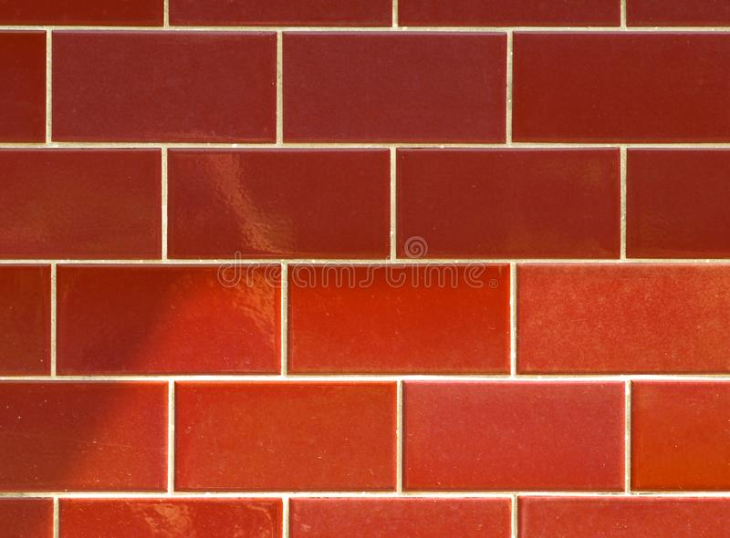 Red ceramic brick tile wall. colorful wall tiles design for bathroom, washroom and kitchen. Background from slate natural stone ti royalty free stock photography