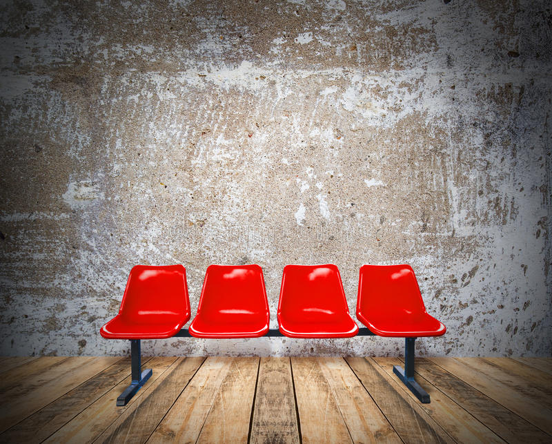 Red chair on a wooden floor and grunge texture background. Red chair on wooden floor and grunge texture background stock photography