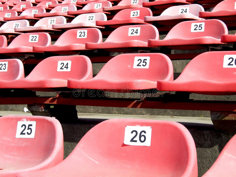 Red chairs. Some red chairs on a stadium royalty free stock images