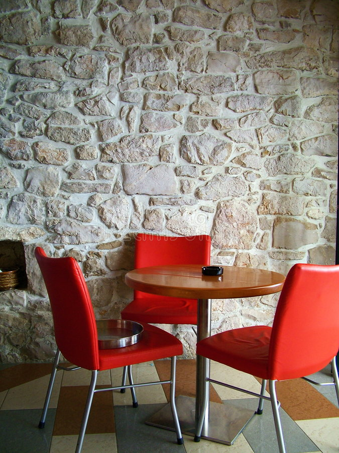 Red chairs. Red, chair, inside, interior, pub, restaurant, rock, wall, chairs, caffee stock photography