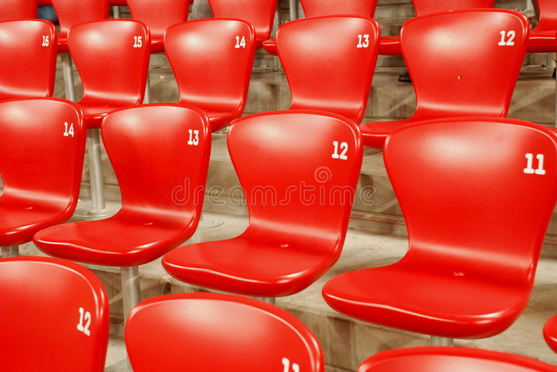 Red chairs. In a gymnasium royalty free stock photography