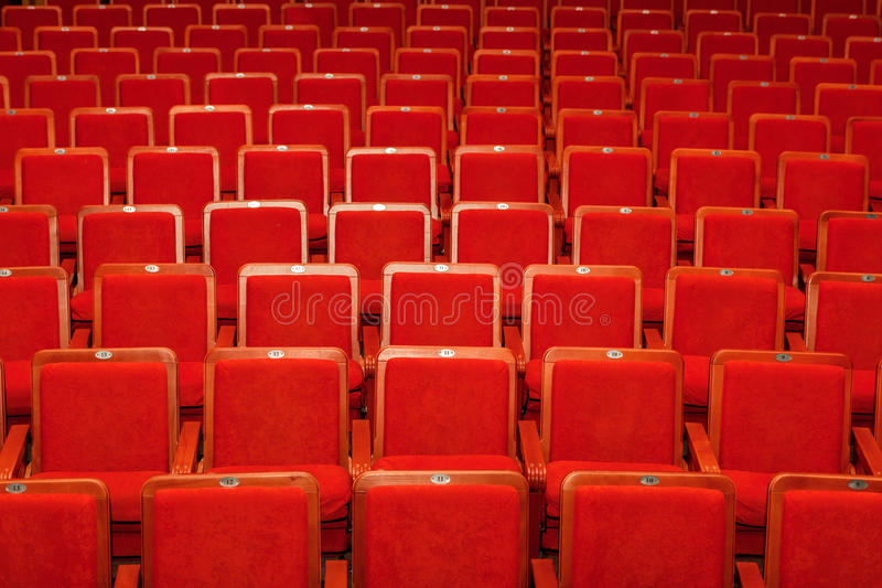 Red chairs for the audience in the cinema or theater.  royalty free stock image