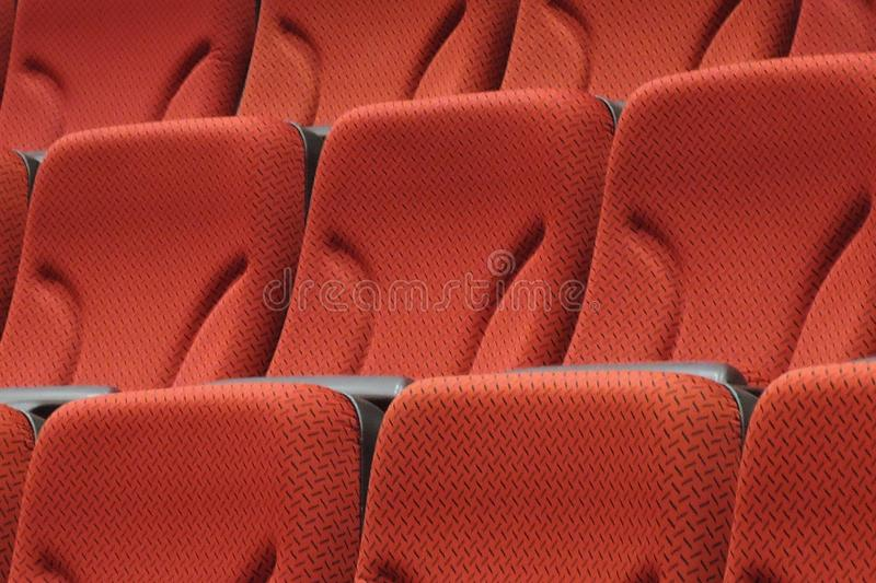 Red chairs in cinema hall stock photo