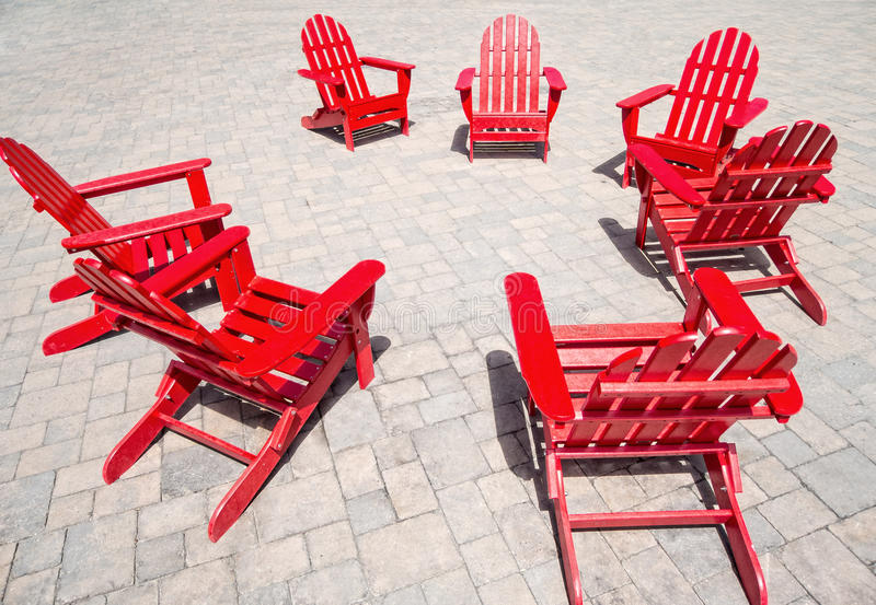 Red chairs. A circle of red Adirondack chairs royalty free stock photo