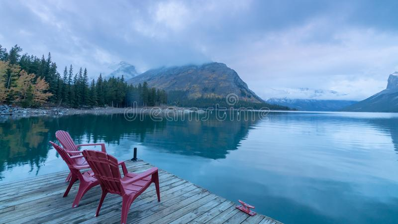 Red chairs on a deck at Lake Minnewanka, Banff national park, Alberta, Canada. Red chair on a deck at Lake Minnewanka, Banff national park, Alberta, Canada stock photo