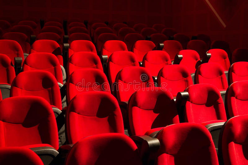 Red chairs on the empty cinema. Auditorium stock image