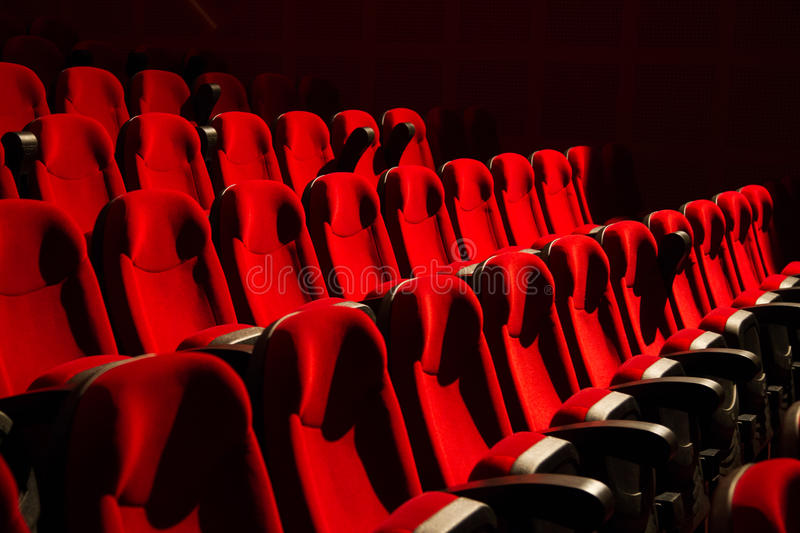 Red chairs on the empty cinema. Auditorium stock photography
