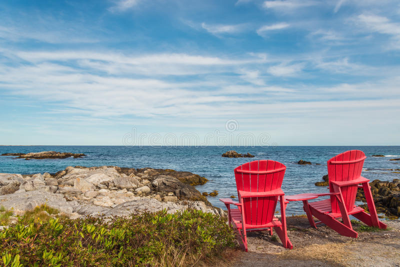 Red chairs facing Keji Seaside beach (South Shore, Nova Scotia,. Canada royalty free stock photography