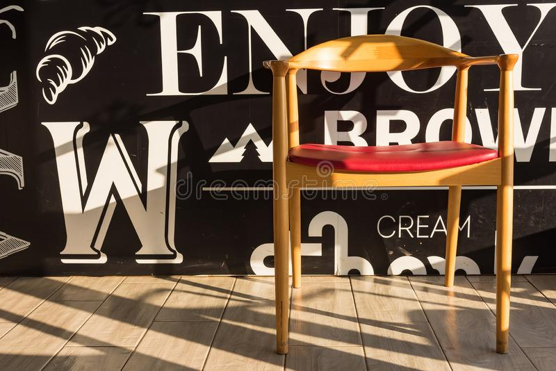 Red chairs on a wooden floor black, elegant piece of interior of restaurant. Retro label decoration style banner graphic vintage symbol travel urban modern stock image