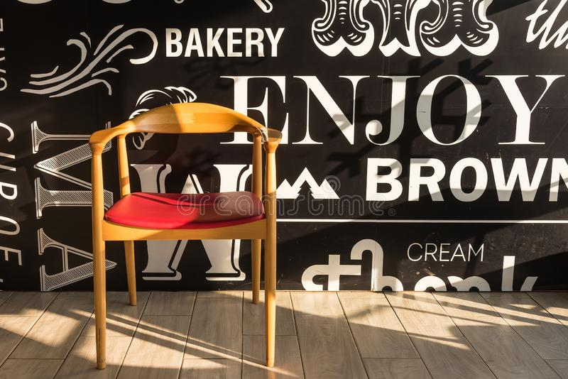 Red chairs on a wooden floor black, elegant piece of interior of restaurant royalty free stock image