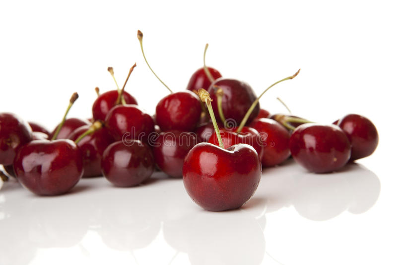Red Cherries. Isolated over a white background stock images