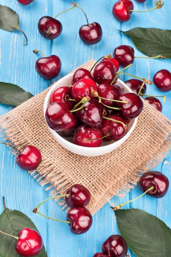 Red cherries in bowl stock photo