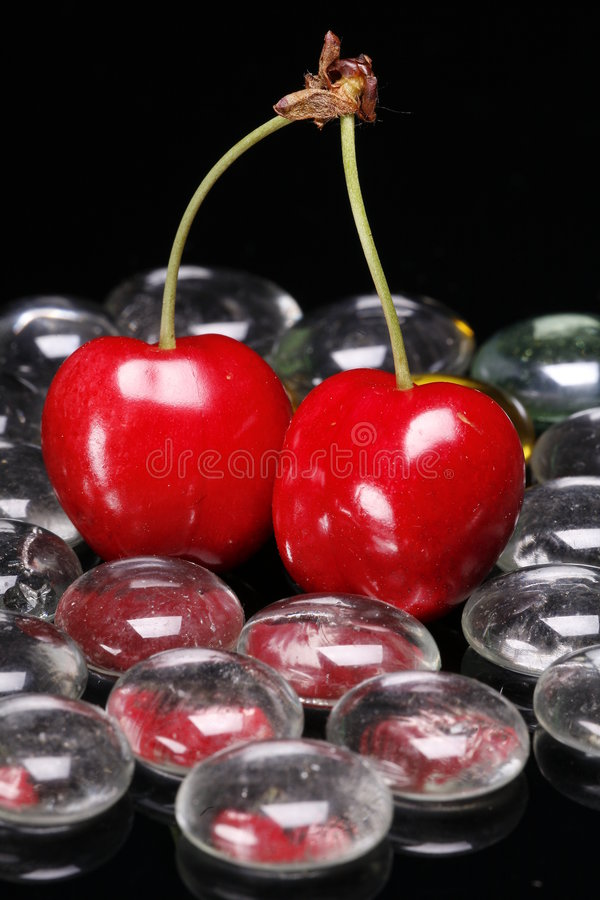 Download Red Cherries With Glass Beads Stock Photo - Image: 5320220