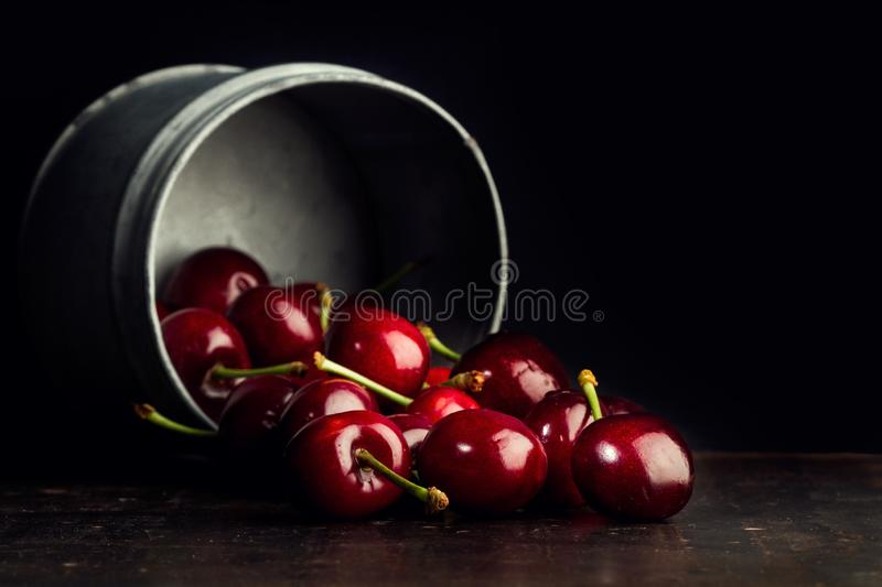 Red cherries in a metal jar royalty free stock photo
