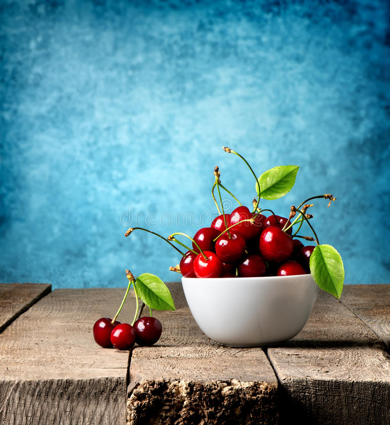Red cherries in plate stock photo