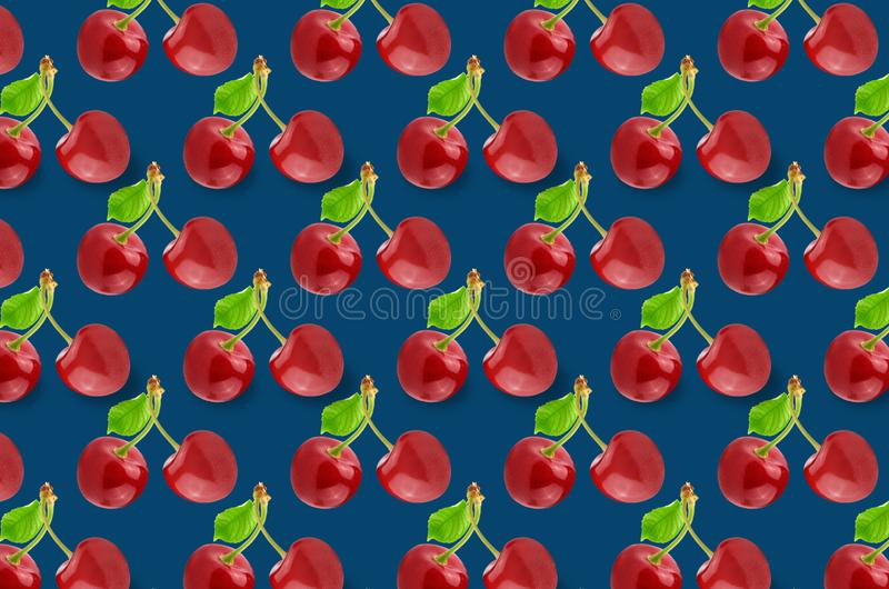 Red cherries slice pattern on colorful background stock image