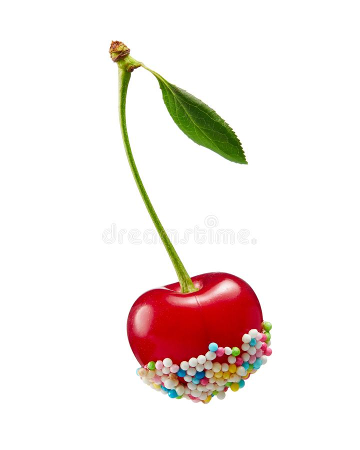 Red cherry, decorated with colorful candy sprinkles, isolated on. Sprinkle covered cherry. Red cherry, decorated with colorful candy sprinkles, isolated on white royalty free stock images