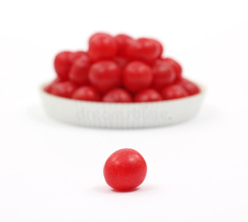 Red cherry sour ball in foreground royalty free stock image