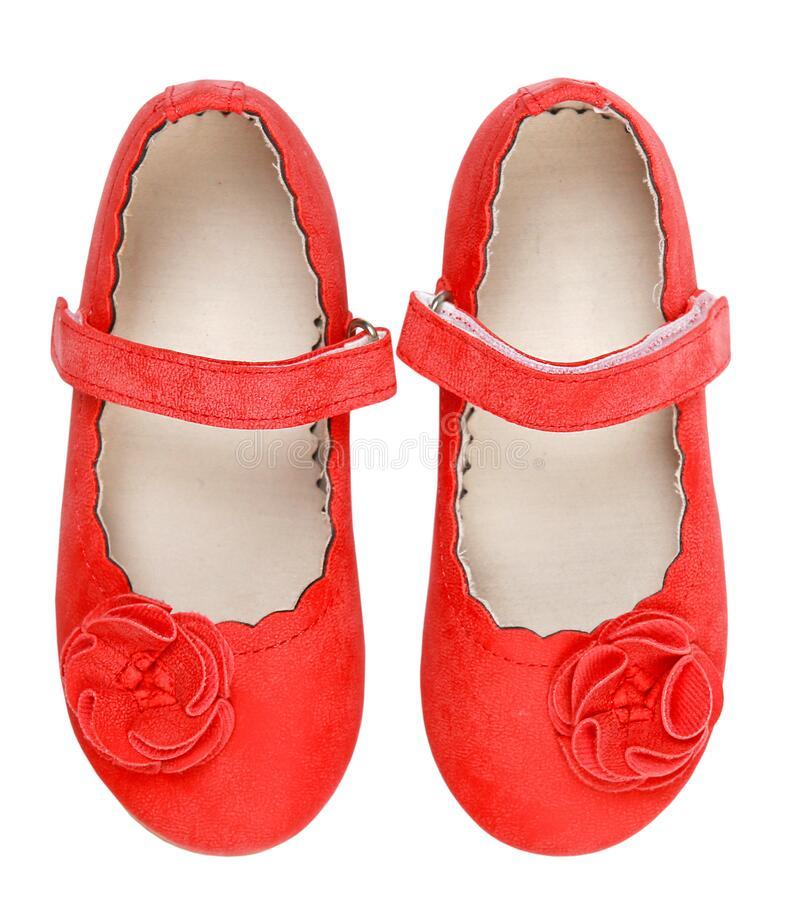 Red child`s flat shoes isolated on white.Kid girl`s elegant footwear top view. Elegant beautiful red child`s shoes pair top view isolated on white.Girl`s flats royalty free stock image
