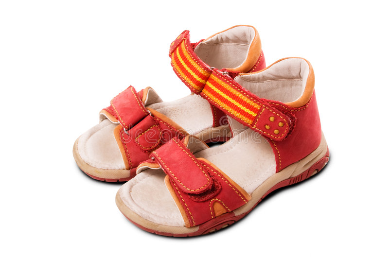 Red Child Sandals. Red baby sandals isolated on white background royalty free stock photography