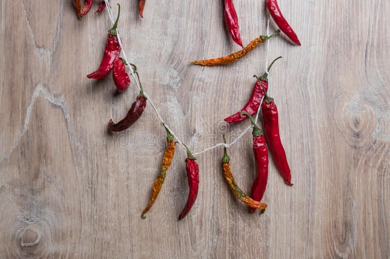Red chili pepper. Dry hot peppers on a wooden background. Bunch of dry red chili peppers. Spice stock image