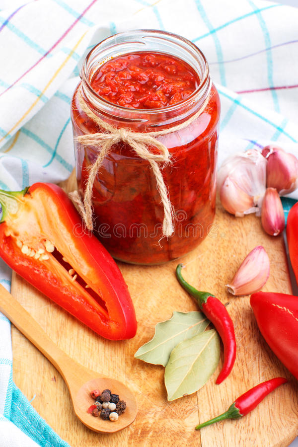 Red chili pepper sauce. Homemade red hot chilli pepper sauce and other ingredients stock image
