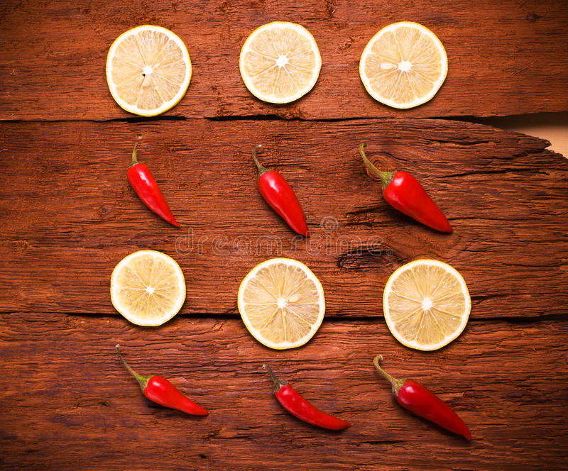 Red chili pepper, slices a lemon royalty free stock photo