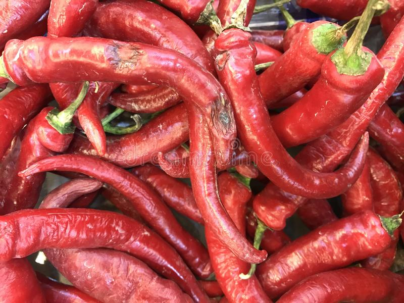 Red chili peppers. A background of red hot chili peppers stock images