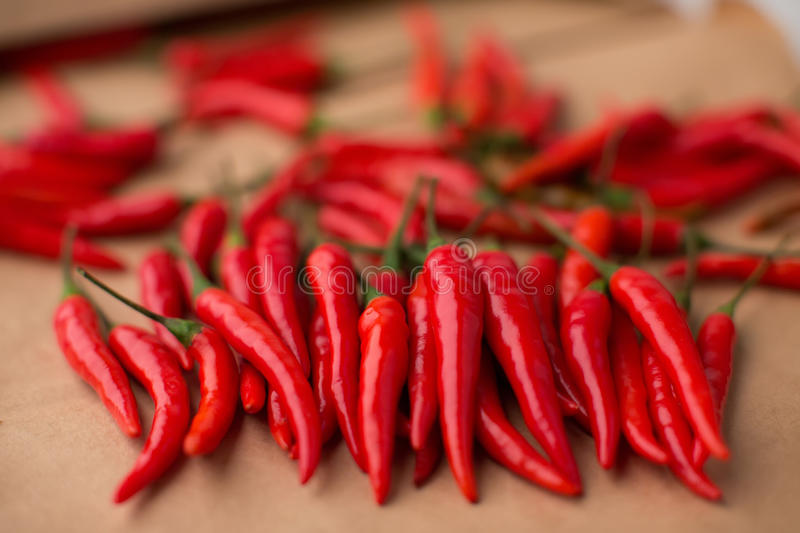 Red chili peppers, closeup view. On table royalty free stock image