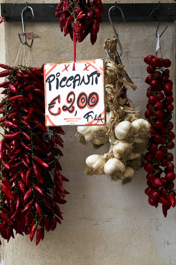 Red chili peppers and garlic for sale stock photography
