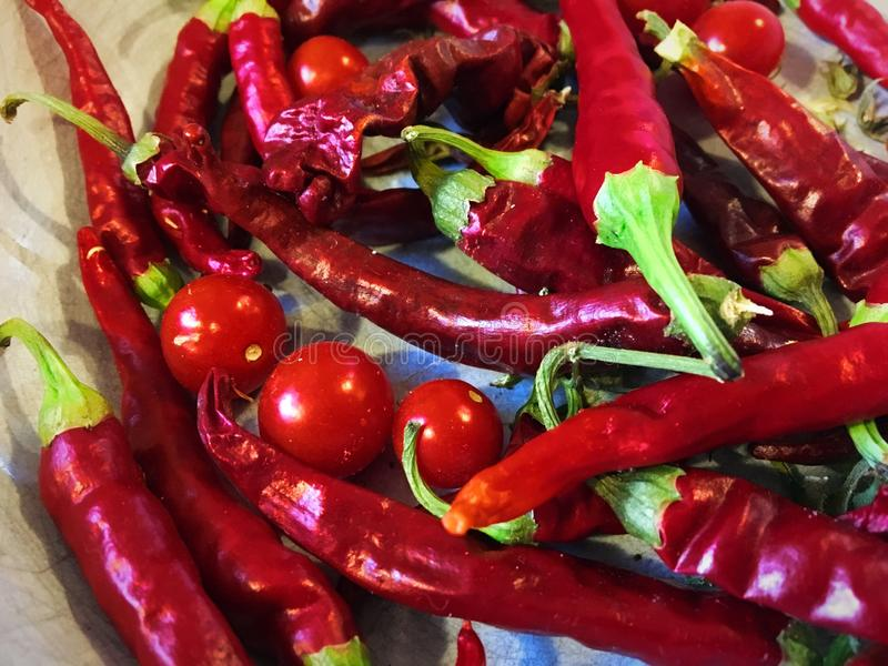 Red chili peppers and tomatoes stock photography
