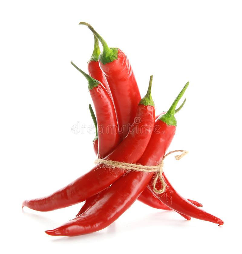 Red chili peppers on white background stock photos