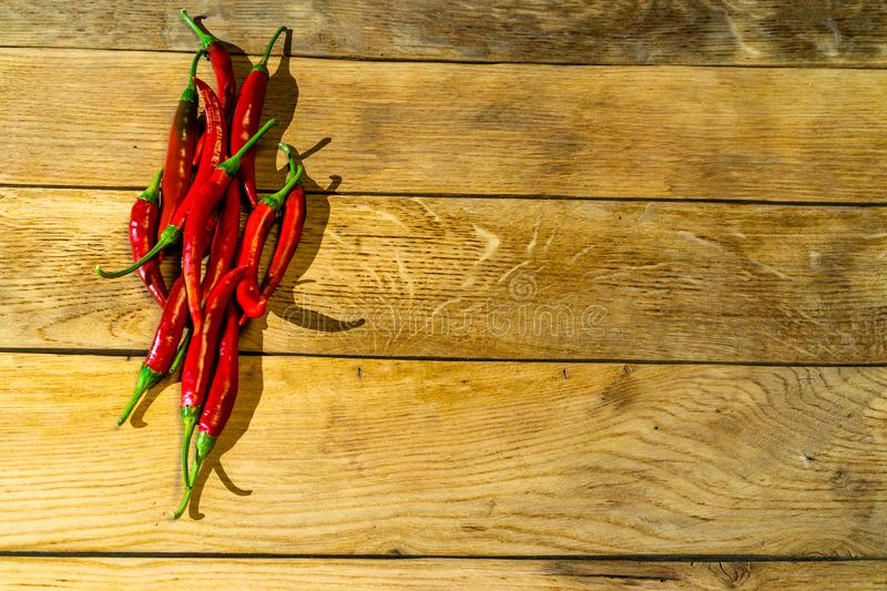 Red chili peppers on a wooden board.  stock photo