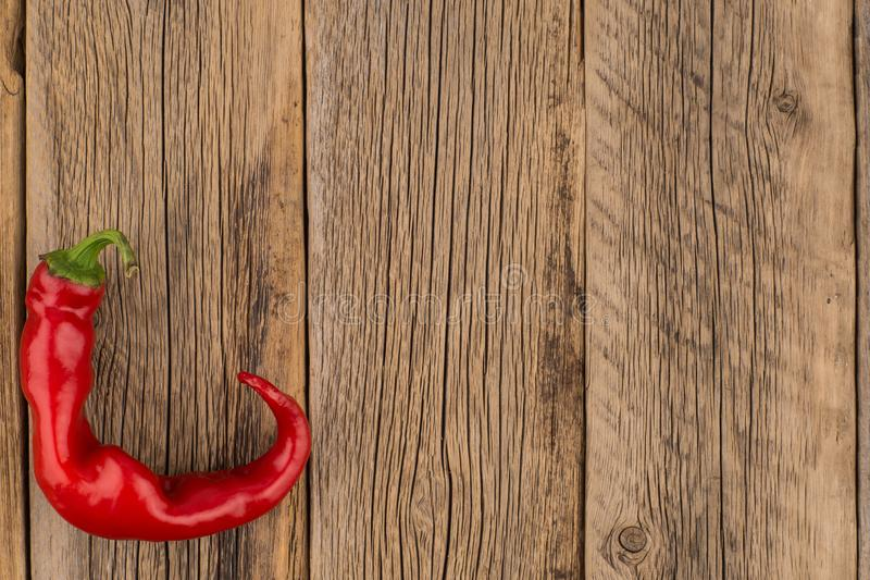 Red chilli pepper on wood background. royalty free stock photos